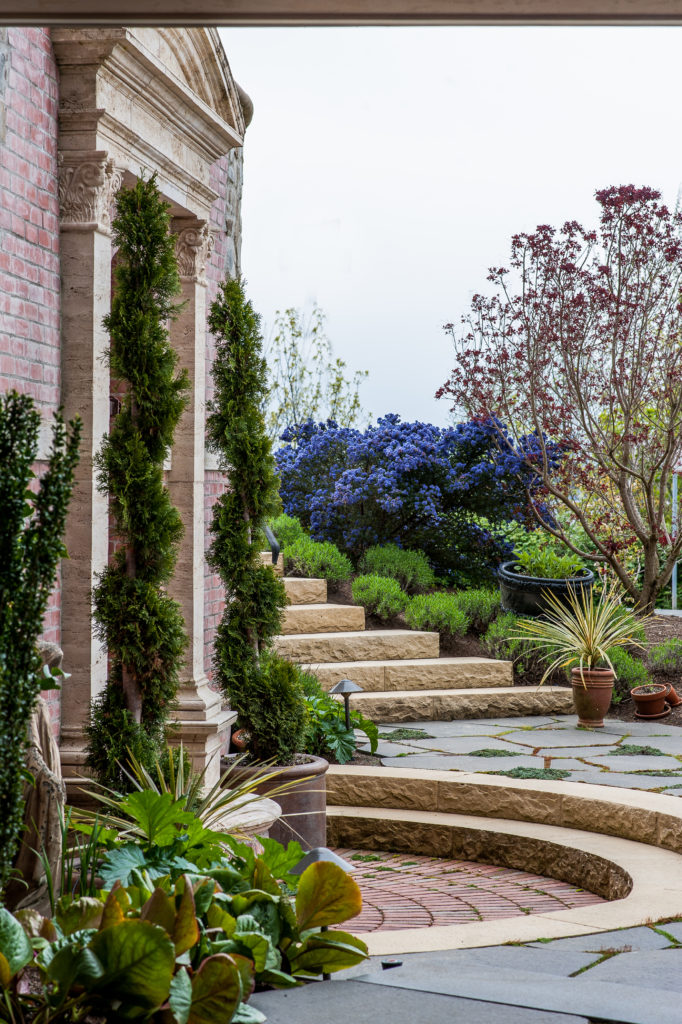 Tuscan style landscape architecture with fountain for luxury home design